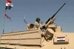 obrazek przedstawiający czołg Abrams z flagą iracką