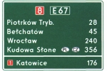 Wzór tablicy E-14 z nazwami dwóch miejscowości kierunkowych